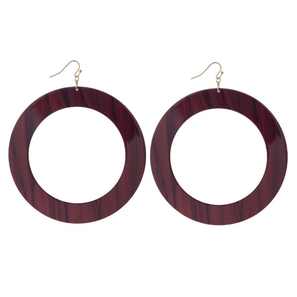 """Gold tone fishhook earring with acetate circle detail. Approximately 3.75"""" in length."""