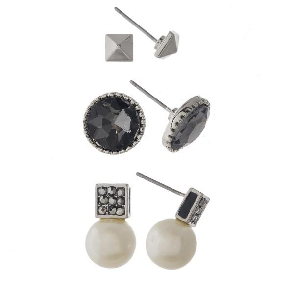 Pearl and rhinestone earring set.