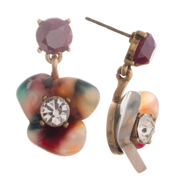 """Crystal stud earring with acetate flower shaped details with center rhinestones. Approximate 1"""" in length."""