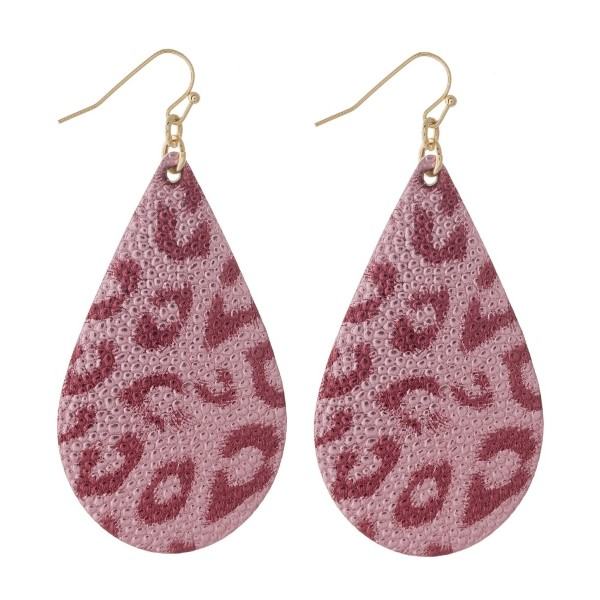 "Gold tone fishhook earring with faux leather teardrop shape. Approximately 2"" in length."