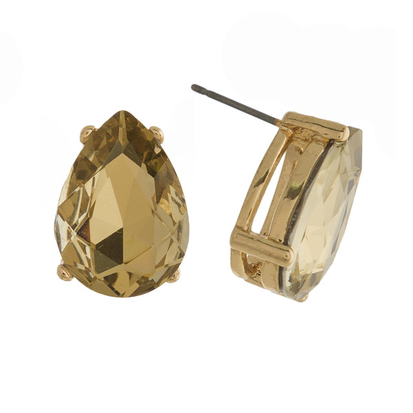 Gold tone stud earring with teardrop rhinestone shape. Approximately 20mm.