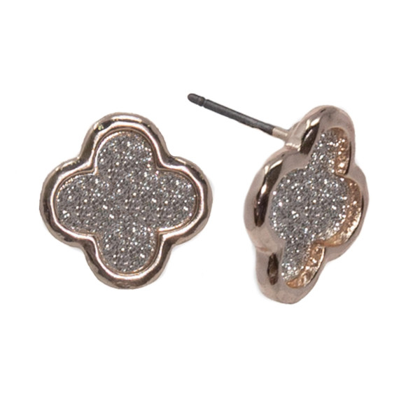 "Metal clover shaped earring with glitter detail. Approximately 1/2"" in length."