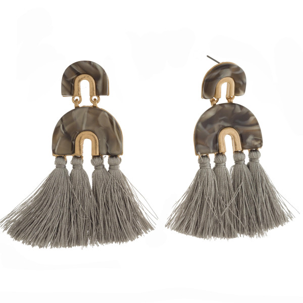 """Stud earring with acetate geometric design and soft tassels. Approximately 3"""" in length."""