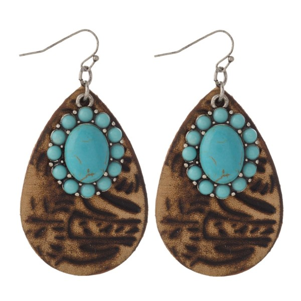 """Faux leather teardrop shaped earring with turquoise charm. Approximately 2"""" in length."""