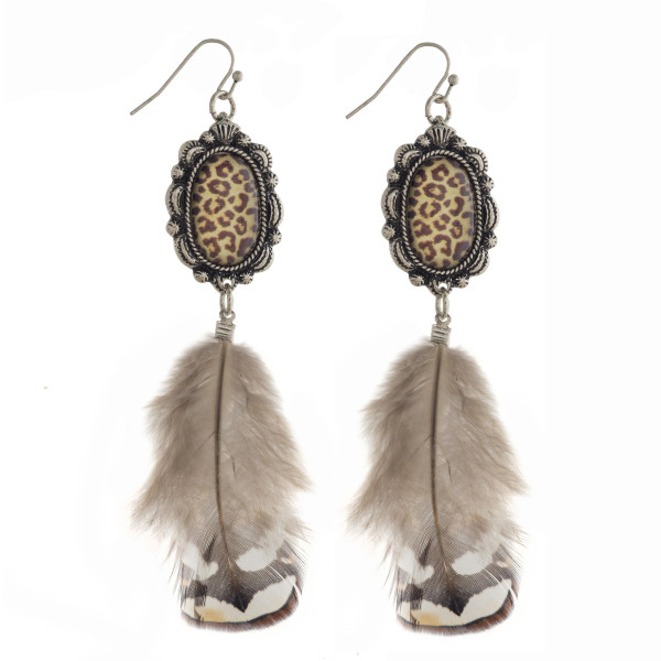 Long animal print fish hook earring with feather.