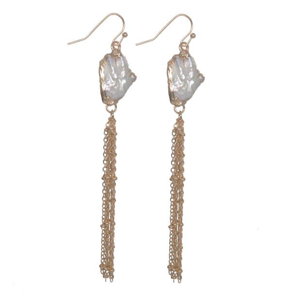 "Fishhook pearl earring with metal tassel. Approximately 3"" in length."