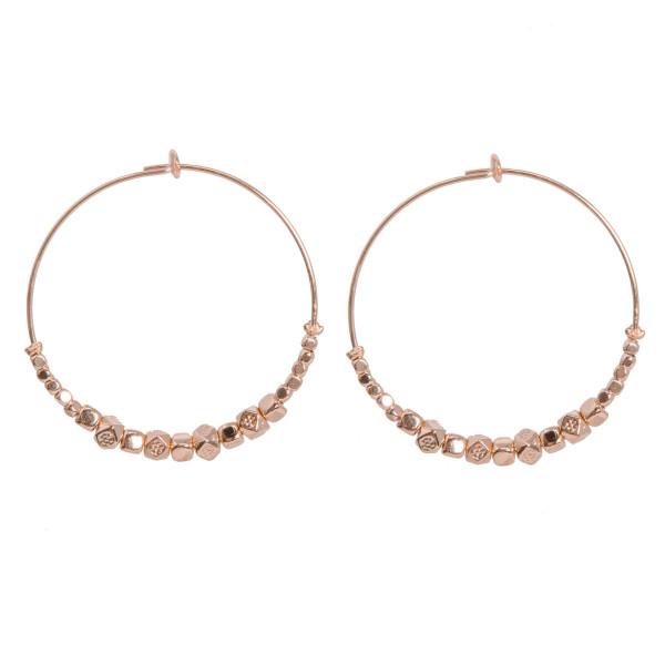"""Metal beaded hoop earring. Approximately 1.5"""" in length."""