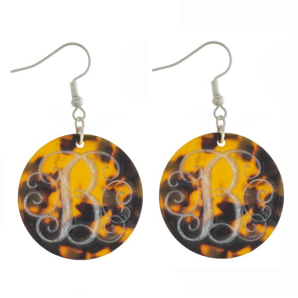 Round fish hook monogram earrings.