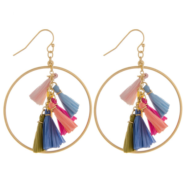 "Round metal earrings featuring raffia tassel center details. Approximately 2"" in length."