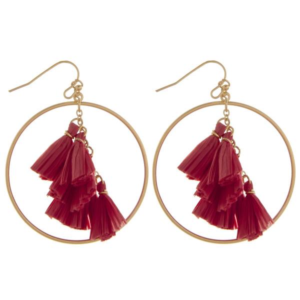 """Long metal hoop earring with tassel dangles. Approximate 2"""" in diameter."""