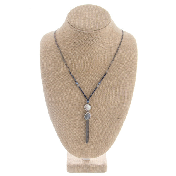 "Long metal necklace featuring a 2 stone pendant with rhinestone details with tassel. Approximate 38"" in length with a 3.0"" pendant."