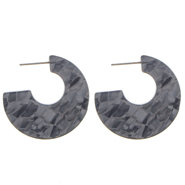 """Short acetate earring with mix designs. Approximate 1"""" in diameter."""