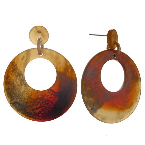 "Long acetate earrings. 1"" in diameter."