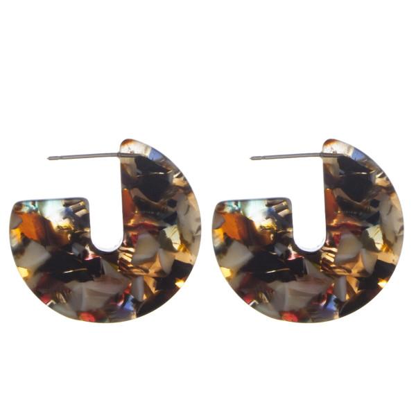 """Short acetate earrings. Approximate 1"""" in diameter."""