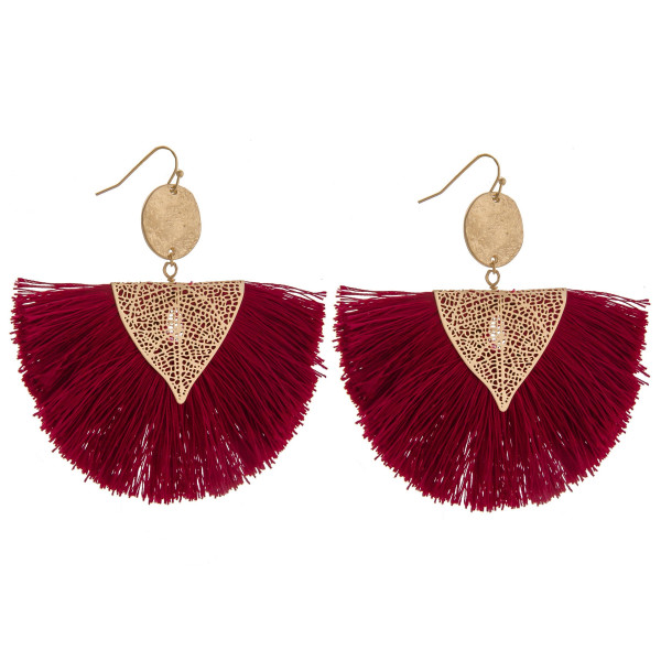 "Gorgeous gold metal fanned earring. Approximately 3"" in width."