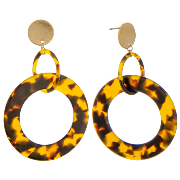 Gorgeous tortoise hoop earrings with gold post. Approximate 1.5 in diameter.