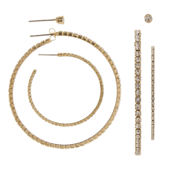 "You won't go wrong with these gorgeous hoop earrings. Gives that perfect Bling! Comes with one stud- One small hoop- One large hoop. Approximate Large hoop 2"" in diameter and small hoop 1"" in diameter."