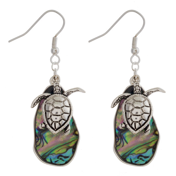 "Gorgeous fishhook abalone earrings with sea charms. Approximate 2"" in length."