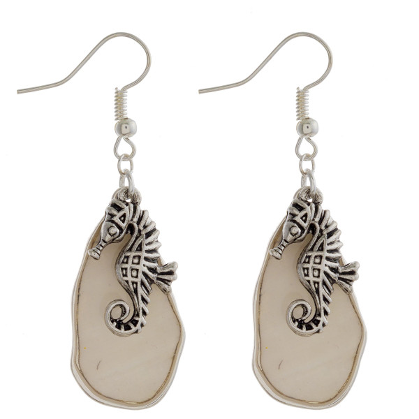 "Gorgeous fishhook Mother of pearl earrings with sea charms. Approximate 2"" in length."