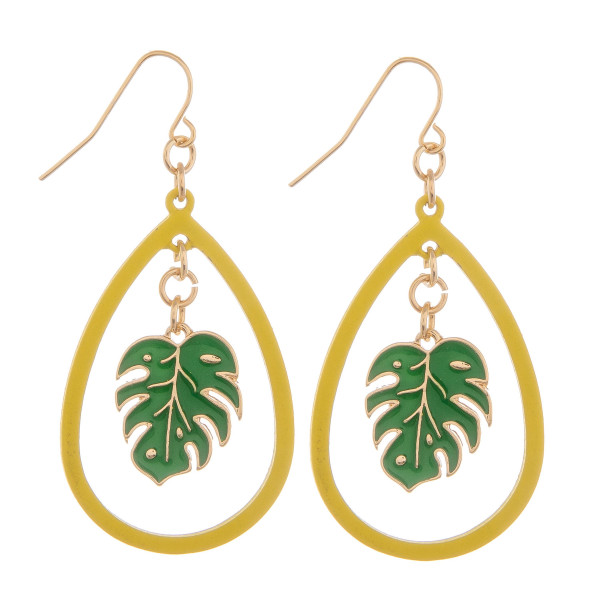 "Long drop earrings with tropical leaf. Approximate 2"" in length."