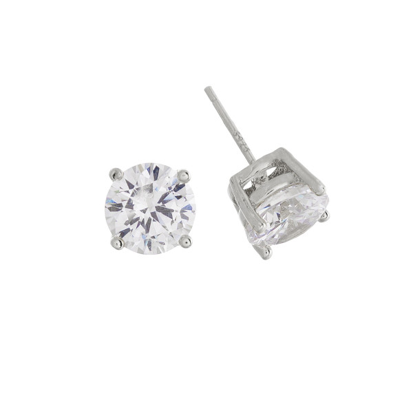 Gorgeous gold dipped cubic zirconia stud earrings. Approximate 7mm.