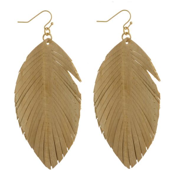 "Long fishhook leaf shape leather earring. Approximate 3"" in length."