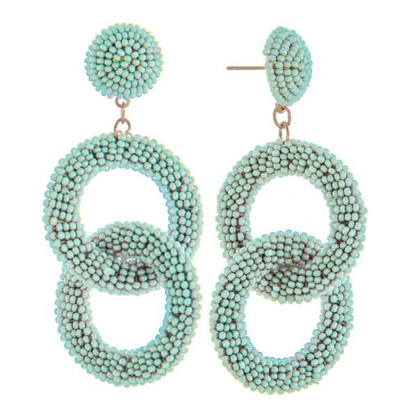 "Long beaded double hoop earring. Approximate 2.5"" in length."