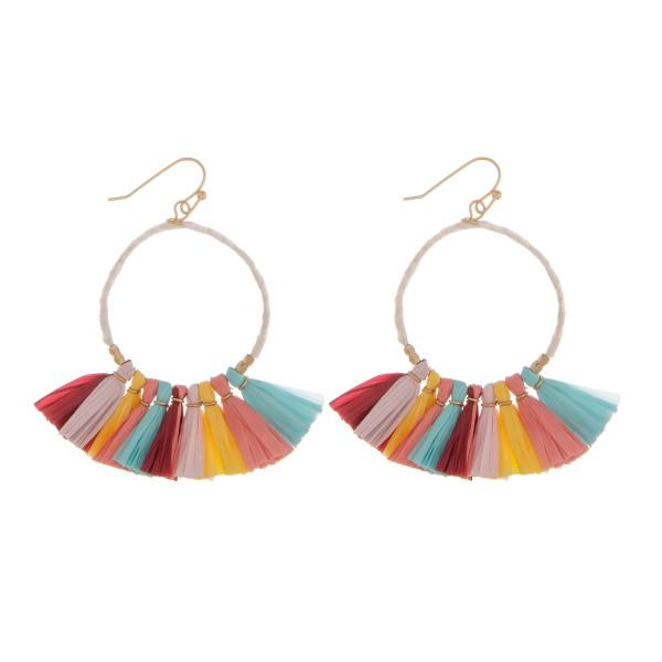 "Long fishhook hoop earrings with raffia details. Approximate 2"" in length."