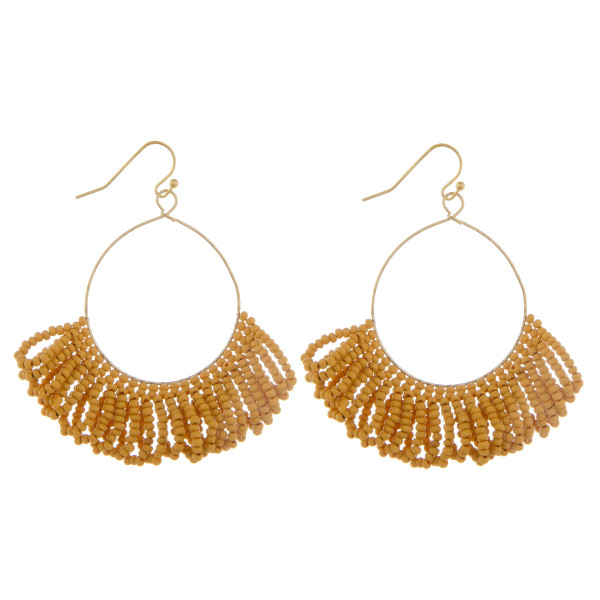 """Long hoop earring with beaded details. Approximate 3"""" in length."""