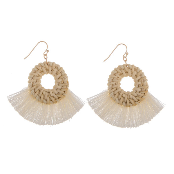 """Long woven raffia and tassel earrings. Approximately 2"""" in diameter."""