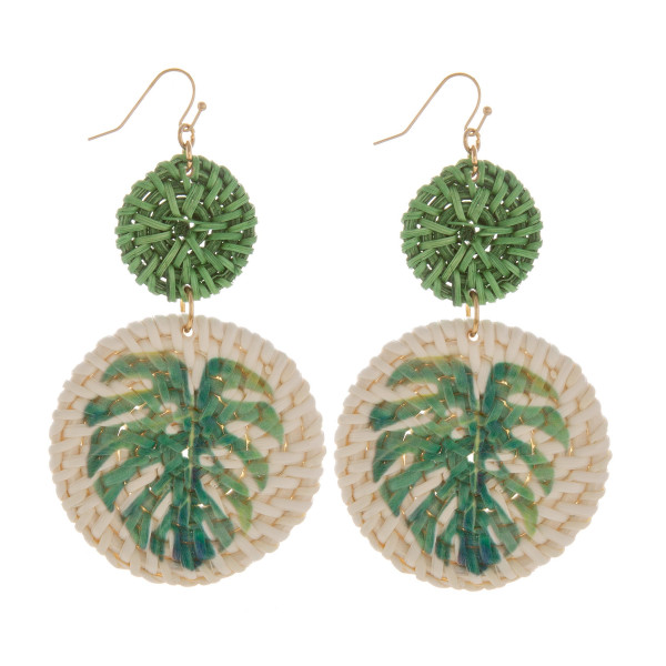 "Gorgeous solid wood hoop earring with tropical leaf print. Approximate. 2"" in length."