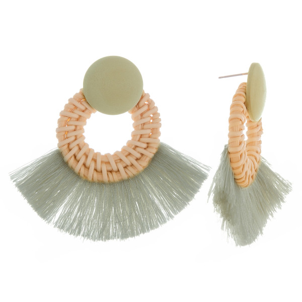 "Long woven raffia hoop earrings with wood post and soft tassel. Approximately 2"" in length."