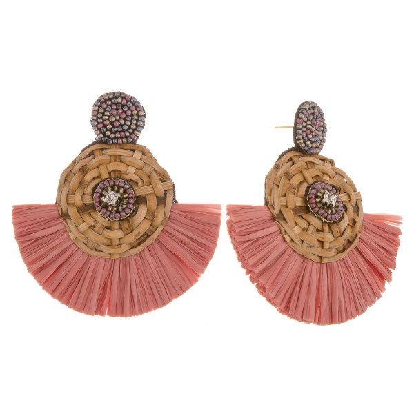 """Long beaded and wood detail raffia earring. Approximate 2.5"""" in length."""