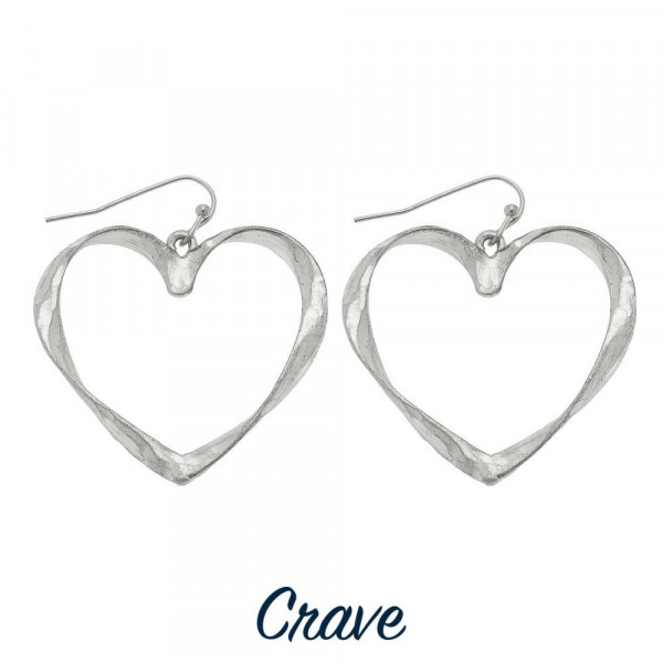 "Hammered metal heart earrings. Approximately 1"" tall x 1"" wide."