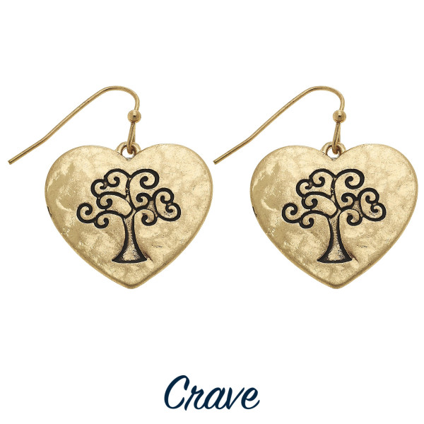 "Heart shaped drop earrings with Tree of Life engraving. Approximately 3/4"" tall."
