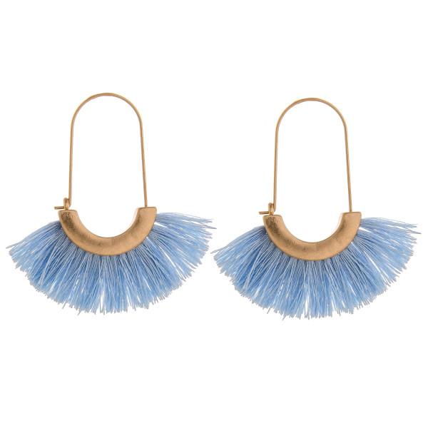 "Long tassel earring with gold trim detail. . Approximate 2"" in length."