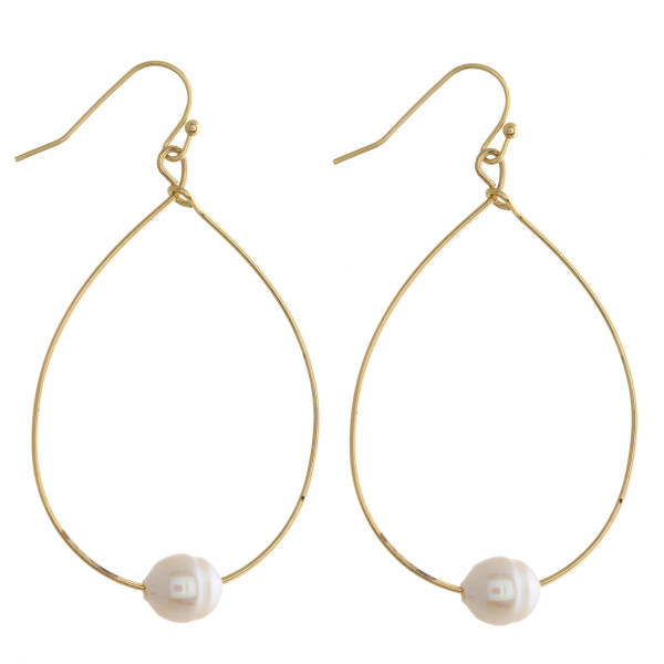 """Long fishhook drop earring with pearl detail. Approximate 2.5"""" in length."""