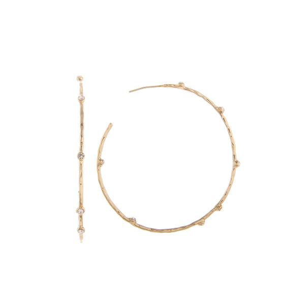 """Long metal hoop earring with rhinestones. Approximate 2"""" in diameter."""