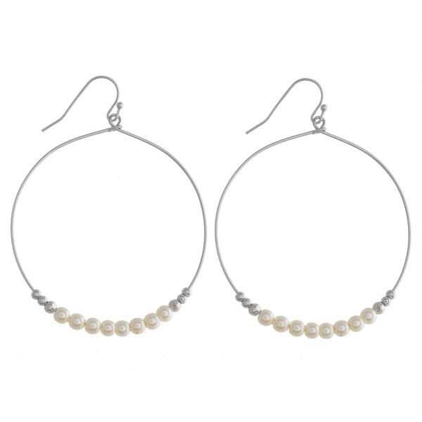 """Long hoop earrings with pearl detail. Approximate 2"""" in diameter."""