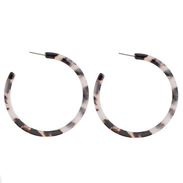 "Long acetate open hoop earring. Approximate 2.5"" in diameter."