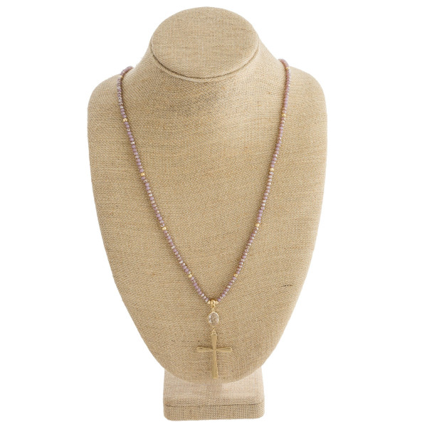 """Long necklace with faceted beads and cross pendant. Approximately 36"""" in length."""