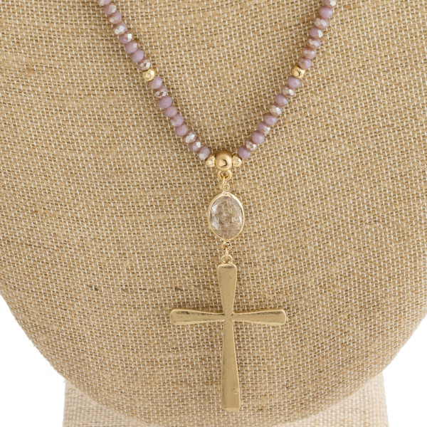 "Long necklace with faceted beads and cross pendant. Approximately 36"" in length."
