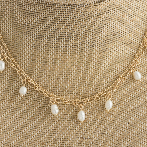 """Short metal necklace with pearl details. Approximate 13 and 14"""" in length."""