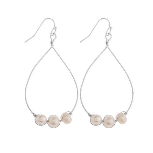 """Long metal drop earrings with pearls. Approximate 2"""" in length."""