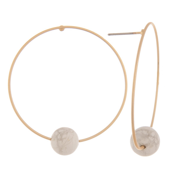 """Long hoop earrings with natural stone detail. Approximate 1.5"""" in length."""