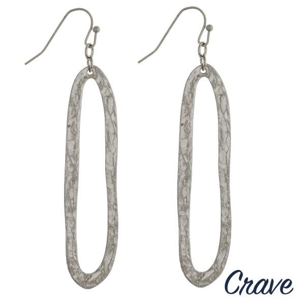 """Long silver metal drop earrings featuring a hammered texture. Approximately 2.25"""" in length."""