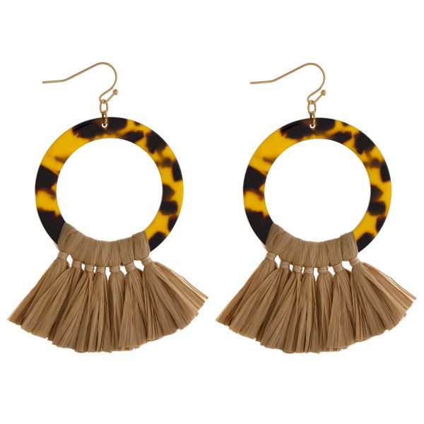 "Long hoop tortoise shell earring with raffia details. Approximate 3"" in length."