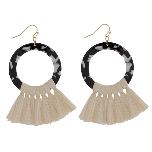 """Long hoop tortoise shell earring with raffia details. Approximate 3"""" in length."""