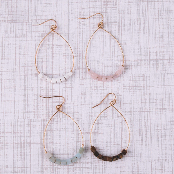"""Metal teardrop earrings featuring rose quartz natural stone beaded details. Approximately 2"""" in length."""