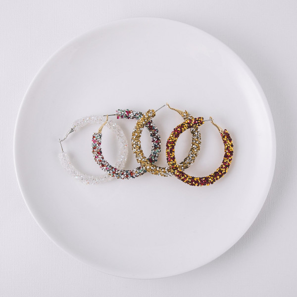 """Large hoop earrings featuring red and gold rhinestones. Approximately 2"""" in diameter."""